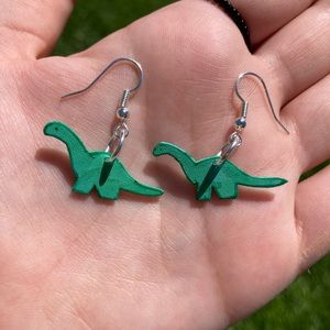 green dinosaur shrinky dink earrings